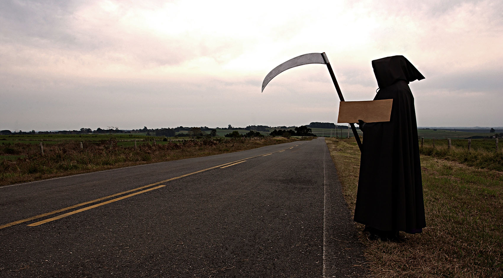 Grim reaper on the side of the road