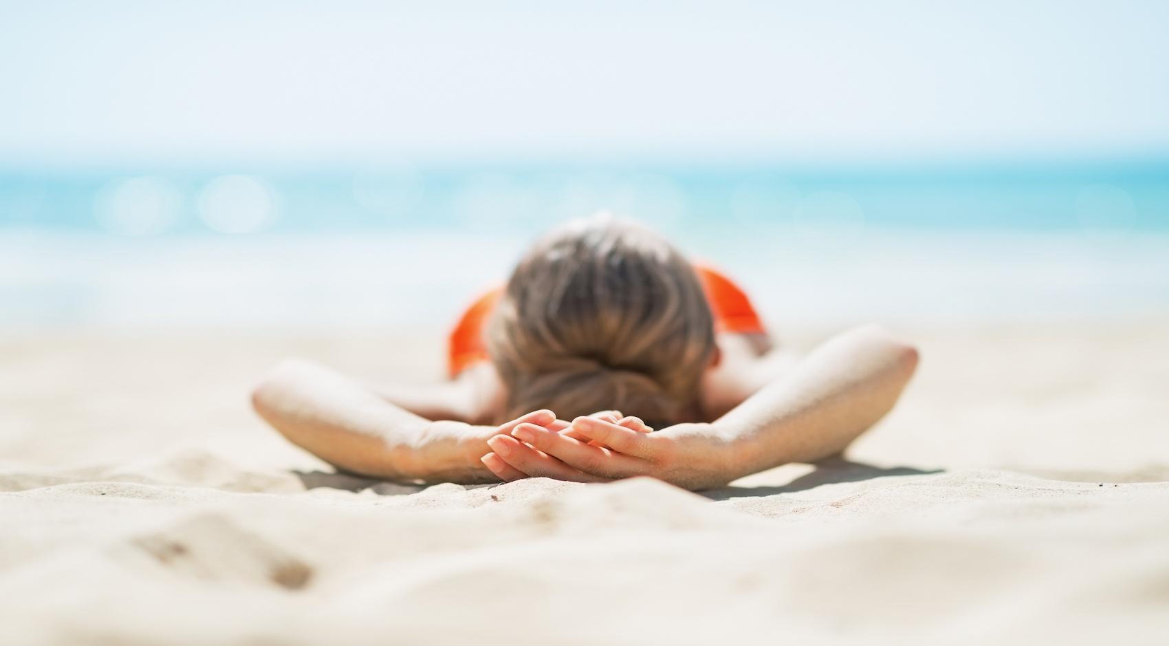 Woman lying on a beach
